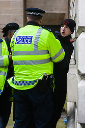 Whitehall, London, April 4th 2015. As PEGIDA UK holds a poorly attended rally on Whitehall, scores of police are called in to contain counter protesters from various London anti-fascist movements. PICTURED: A young anti-fascist is arrested after attempting to break through police lines into the PEGIDA enclosure.