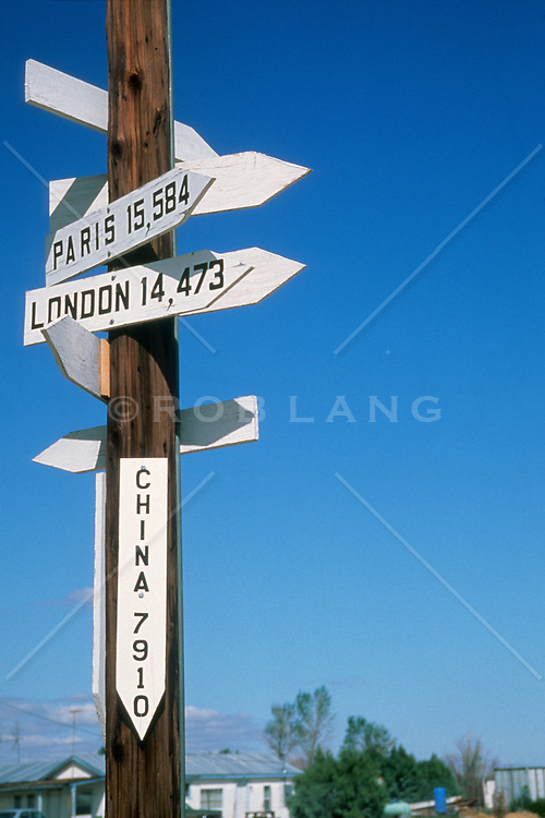 cities and distances to many cities posted on a pole