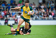 Australia full-back Jack Maddocks breaks through a tackle from New Zealand hooker Leni Apisai during the World Rugby U20 Championship 5rd Place play-off  match Australia U20 -V- New Zealand U20 at The AJ Bell Stadium, Salford, Greater Manchester, England on Saturday, June  25  2016.(Steve Flynn/Image of Sport)