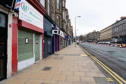Edinburgh, Scotland, UK. 24 March, 2020.  Deserted streets along Leith Walk. All shops and restaurants are closed with very few people venturing outside following the Government imposed lockdown today. Iain Masterton/Alamy Live News