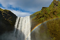 Skógafoss is a 60 meter high waterfall in southern Iceland. In the evening it is positioned perfectly for vivid rainbows to appear in the mist. I got here at the perfect time, once I made it to the top and back the rainbow was already gone.
