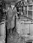 Y-480722B-03.  Worker spraying on seats. 900 bus victim of Vanport flood. Before restoration. Detail shots. Cleaning, paint shop. July  22, 1948