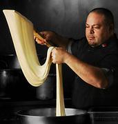 Chef making mozzarella cheese