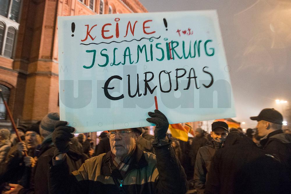 """05 JAN 2015, BERLIN/GERMANY:<br /> Demonstrant mit einem Schild """"Keine Islamisierung Europas"""", Bärgida-Demo """"Berliner Patrioten gegen die Islamisierung des Abendlandes"""", Spandauer Strasse<br /> IMAGE: 20150105-01-042<br /> KEYWORDS: Bärgida, Demonstranten, Protest, Demonstration"""