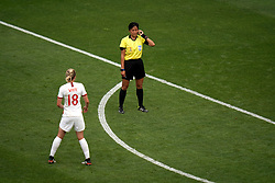 Match referee Qin Liang consults VAR after England's Ellen White (18) scores her side's second goal of the game but it is given as offisde on the field during the FIFA Women's World Cup, round of Sixteen match at State du Hainaut, Valenciennes.