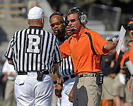 Oklahoma State head coach Mike Gundy argues with the Official Tom Walker in the first half against Kansas State at Bill Snyder Family Stadium in Manhattan, Kansas, October 7, 2006.  The Wildcats beat the Cowboys 31-27.<br />