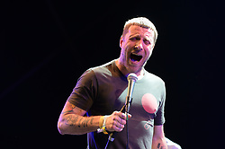 Jason Williamson of Sleaford Mods performing on The Park Stage at the Glastonbury Festival, at Worthy Farm in Somerset.