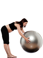 pregnant caucasian woman stretching with fitness ball isolated studio on white background