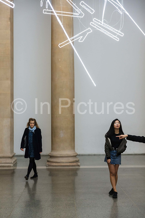 The work Forms in Space… by Light in Time, a major new light installation by Cerith Wyn Evans was created for the annual Tate Britain 2017 Commission, where a contemporary British artist was invited to create a new artwork in response to the grand space of the Duveen Galleries, at the heart of Tate Britain ON 3rd May 2017 in London, United Kingdom. These drawings in space takes inspiration from the codified and precise movements of Japanese Noh theatre, reflecting the artist's interest in choreology – the practice of translating movement, such as dance, into notational form, like a musical score.