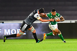 Monty Ioane of Benetton Treviso evades the tackle of Adam Beard of Ospreys<br /> <br /> Photographer Craig Thomas/Replay Images<br /> <br /> Guinness PRO14 Round 4 - Ospreys v Benetton Treviso - Saturday 22nd September 2018 - Liberty Stadium - Swansea<br /> <br /> World Copyright © Replay Images . All rights reserved. info@replayimages.co.uk - http://replayimages.co.uk