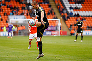 Wimbledon forward James Hanson (18) brings the ball under control during the EFL Sky Bet League 1 match between Blackpool and AFC Wimbledon at Bloomfield Road, Blackpool, England on 20 October 2018.