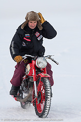 Oleg Kapkaev on his antique IZH Soviet motorcycle (the company that manufactured Kalashnikov rifles) at the Baikal Mile Ice Speed Festival. Maksimiha, Siberia, Russia. Saturday, February 29, 2020. Photography ©2020 Michael Lichter.