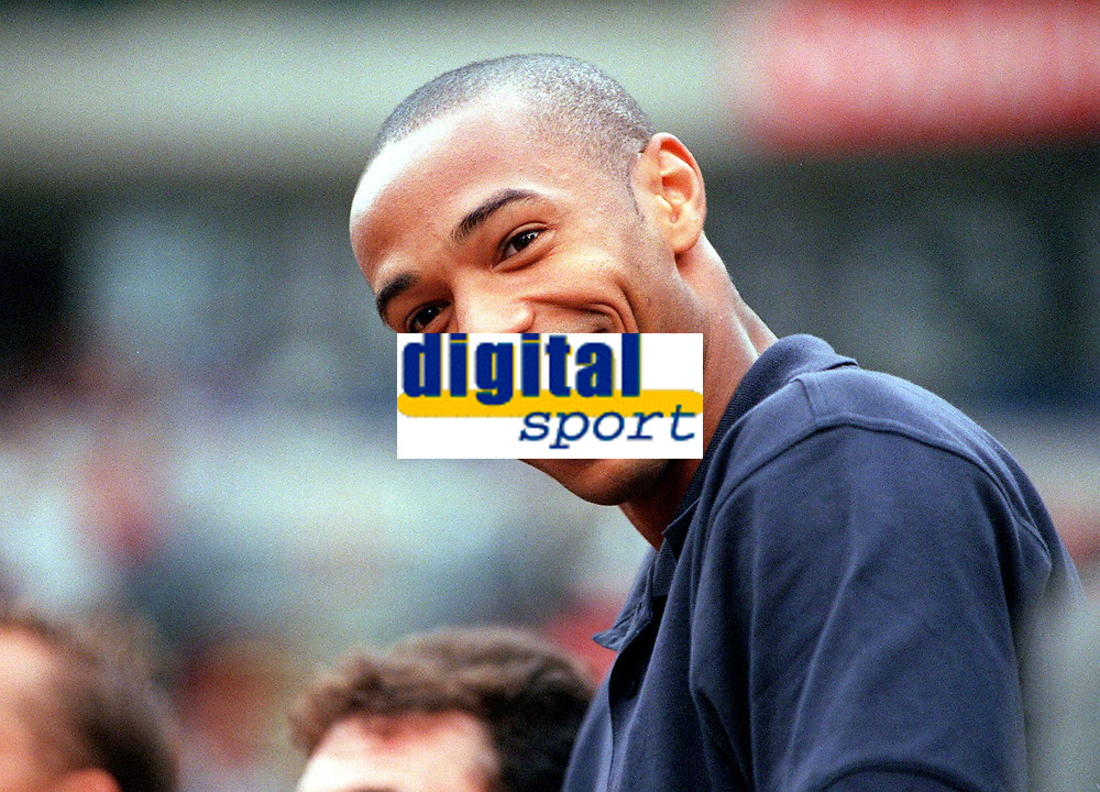 Thierry Henry (Arsenal) watches the game from the stand. Arsenal v FC Barcelona, The Amsterdam Tournament, Amsterdam Arena, Holland, 3/8/2000. Credit Colorsport / Stuart MacFarlane.