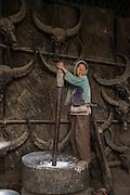 Konyak Naga pounding rice<br /> Konyak Naga headhunting Tribe<br /> Mon district<br /> Nagaland,  ne India