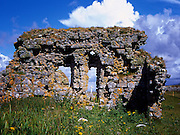 Ruins of Howmore Chapel, South Uist, Hebrides,Scotland.<br /> <br /> Howmore (An t'-Hogh Mor), 12 th/13 th century (if Norse origin, haugr = burial mound).<br /> <br /> Occupying a prehistoric site and possibly dating back to the 6th century (an Early Christian graveslab lies among the ruins), this fragmentary group of two medieval churches and two surviving chapels is one of the most important religious sites in the Outer Hebrides. It became an important seat of learning during the Lordship of the Isles and was the burial place of the Clanranald chiefs after the Reformation.<br /> <br /> By the end of the 17th century the buildings were probably ruinous. Several burial enclosures and the kirkyard wall, mid-late 19th century.