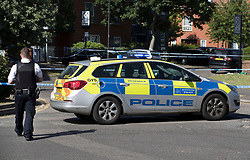 © Licensed to London News Pictures. 11/06/2018. London, UK. Police guard a cordon where a 17 year old was critically injured in a stabbing in Harrow last night. Police are also dealing with a stabbing incident in nearby Northolt where a 20 year old was injured.Photo credit: Peter Macdiarmid/LNP  Photo credit: Peter Macdiarmid/LNP