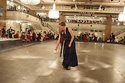 LAURA IRWIN, SPRINKLING TALCUM POWDER, The Royal Caledonian Ball 2013. The Great Room, Grosvenor House. Park lane. London. 3 May 2013.