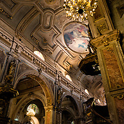 Chandelier and pulpit in the Metropolitan Cathedral of Santiago (Catedral Metropolitana de Santiago) in the heart of Santiago, Chile, facing Plaza de Armas. The original cathedral was constructed during the period 1748 to 1800 (with subsequent alterations) of a neoclassical design.