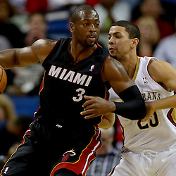 Oct 23, 2013; New Orleans, LA, USA; Miami Heat shooting guard Dwyane Wade (3) is guarded by New Orleans Pelicans shooting guard Austin Rivers (25) during the second half of a preseason game at New Orleans Arena. The Heat defeated the Pelicans 108-95. Mandatory Credit: Derick E. Hingle-USA TODAY Sports