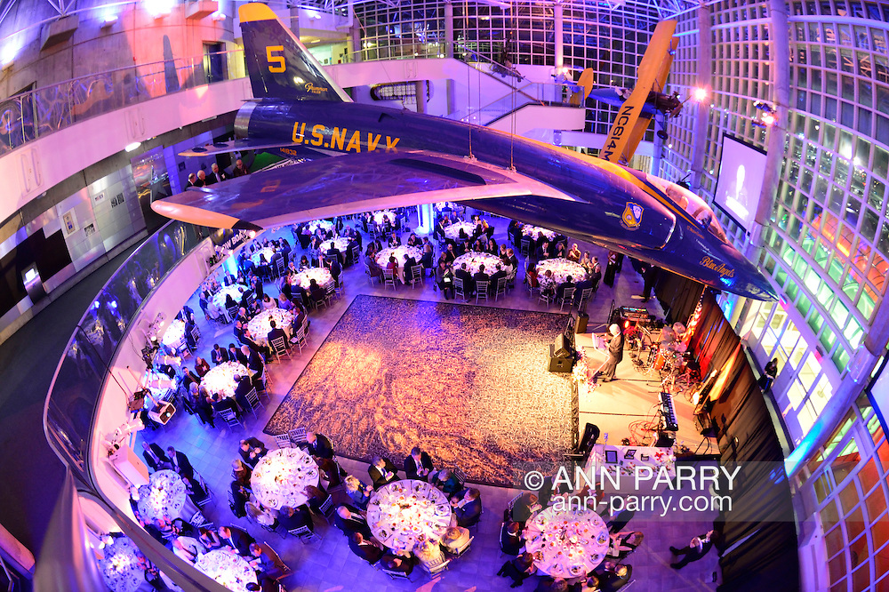 """Feb. 27, 2013 - Garden City, New York, U.S. -  HARRISON H. SCHMITT, Apollo 17 Astronaut and former U.S. Senator, is honored with the Spirit of Discovery Award, at the 10th Annual Cradle of Aviation Museum Air & Space Gala, celebrating the 40th Anniversary of Apollo 17. A Grumman F11 (F-11) Tiger jet with """"U.S. Navy"""" on its side is suspended from the three floor atrium lobby, and Sen. Schmitt is at the table to left of stage, where ANDREW PARTON, the Executive Director of the museum, is speaking. 180 degree fish eye lens view from above."""