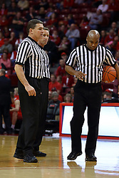 26 November 2016:  Paul Janssen (left), Jeb Hartness (center) and Ervin Wilson (right) discuss a double technical foul situation during an NCAA  mens basketball game between the Ferris State Bulldogs the Illinois State Redbirds in a non-conference game at Redbird Arena, Normal IL