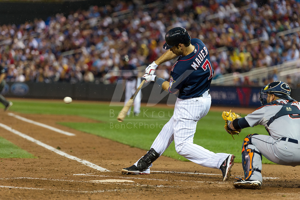 Joe Mauer (7) of the Minnesota Twins bats during a game against the Detroit Tigers on August 14, 2012 at Target Field in Minneapolis, Minnesota.  The Tigers defeated the Twins 8 to 4.  Photo: Ben Krause