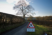 English & Welsh dual language roadwork sign in the Black Mountains, Powys, Wales, United Kingdom