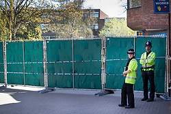 © Licensed to London News Pictures. 20/04/2018. Salisbury, UK. Police officers stand next to new barriers erected in the Maltings shopping area as a cleanup operation begins in Salisbury. Former Russian Spy Sergei Skripal and his daughter Yulia were poisoned using a nerve agent in the city lady month. Experts have warned that 'Toxic levels' of the nerve agent novichok could still be present at hot spots around the city. Photo credit: Peter Macdiarmid/LNP