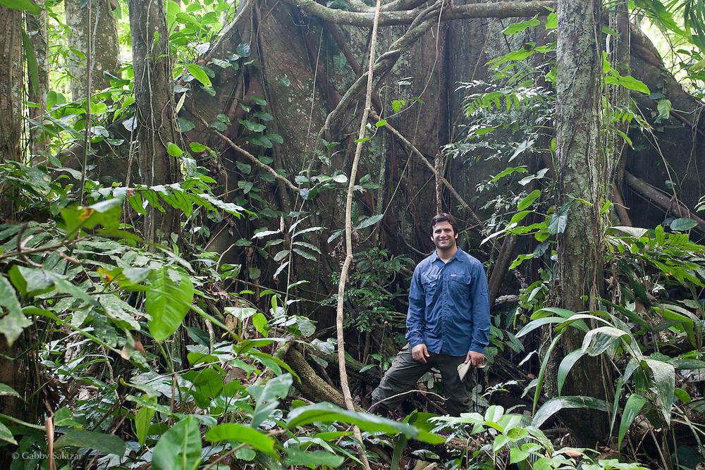 Gabriel Chait in front of arge tree on Trocha 14. Los Amigos Conservation Concession run by the Amazon Conservation Association and the Asociación para la Conservación de la Cuenca Amazónica. The concession is on the Rio Madre de Dios and the Rio Los Amigos. It protects lowland rainforest in the Los Amigos - Tambopata Conservation Corridor and has a biological research station called CICRA.