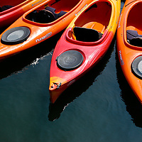 Kayaks lined up at the dock in Damariscotta, Maine.