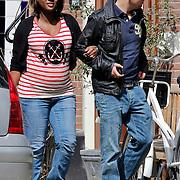 NLD/Amsterdam/20100424 -  Zwangere Edsilia Rombley en partner Tjeerd Oosterhuis wandelend door Amsterdam Zuid