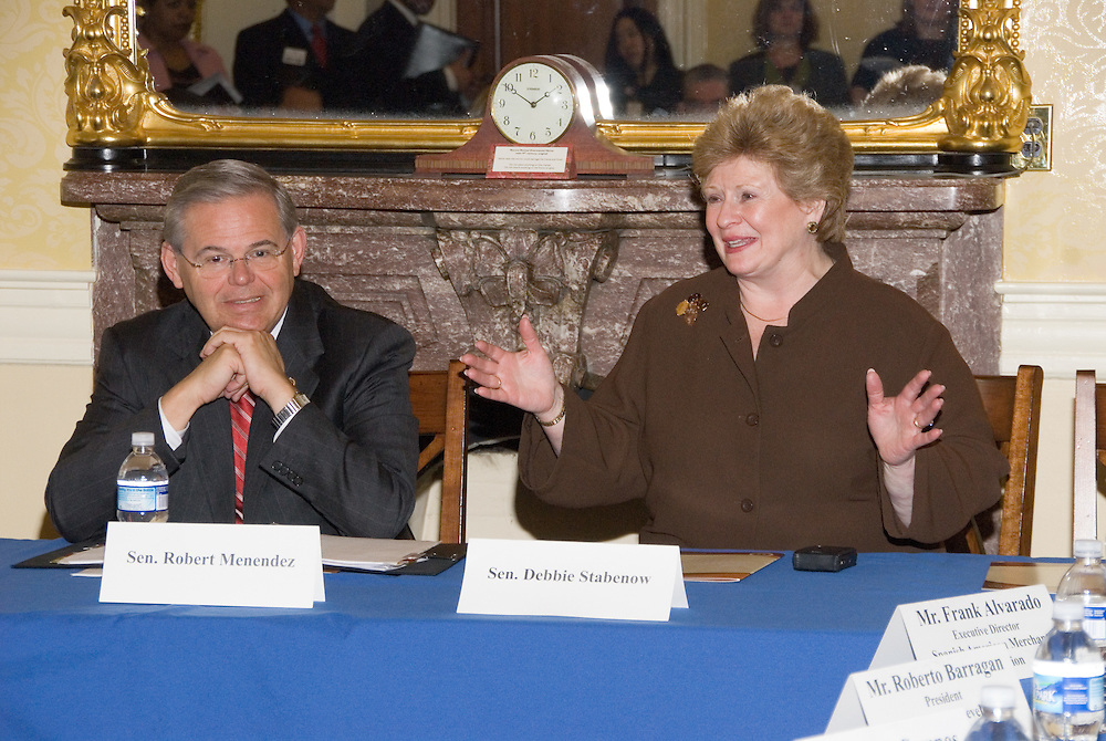 Senator Robert Menendez (D-NJ) listens as Senator Debbie Stabenow (D-MI) speaks with a select group of Hispanic business executives at the US Capitol, attending theUnited States Hispanic Chamber of Commerce's 19th Annual Legislative Conference, in Washington, DC, Wednesday, March 11, 2009.