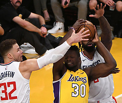 December 29, 2017 - Los Angeles, California, U.S. - Los Angeles Lakers forward Julius Randle (30) scrambles for the ball against LA Clippers forward Blake Griffin (32) and teammate DeAndre Jordan (6) in the first half of a NBA Basketball game at Staples Center on Friday, Dec. 29, 2017 in Los Angeles. (Credit Image: © Keith Birmingham/SCNG via ZUMA Wire)
