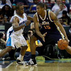 April 11, 2011; New Orleans, LA, USA; Utah Jazz power forward Derrick Favors (15) is guarded by New Orleans Hornets point guard Chris Paul (3) during the second half at the New Orleans Arena. The Jazz defeated the Hornets 90-78.  Mandatory Credit: Derick E. Hingle