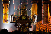 People carry a mikoshi or portable shrine through the entrance gate to Tokyo`s controversial Yasukuni shrine during the Mitama matsuri in remembrance of Japan`s war dead. Tokyo, Japan. Sunday, July 13th 2008