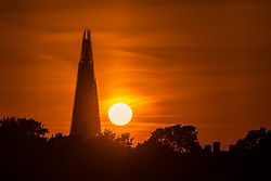 © Licensed to London News Pictures. 17/09/2018. London, UK.  Sunset behind the London shard following a day of warm and sunny autumn weather in the capital.  Photo credit: Vickie Flores/LNP