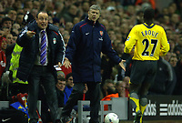 Photo: Paul Greenwood.<br />Liverpool v Arsenal. The FA Cup. 06/01/2007. Liverpool manager Rafael Benitez, left, urges his players on as Arsene Wenger, centre, questions Eboue's effort