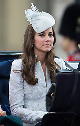© London News Pictures.. 14/06/2014. Catherine, Duchess of Cambridge riding in a carriage from Buckingham Palace during the annual Trooping the Colour Ceremony in central London. The event marks the queens official birthday. . Photo credit:Ben Cawthra/LNP