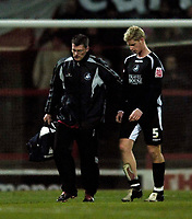 Photo: Jed Wee.<br />Doncaster Rovers v Swansea City. Coca Cola League 1.<br />17/12/2005.<br />Swansea lose Alan Tate (R) to injury during the second half.