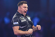 Gerwyn Price hits a double and wins a leg and celebrates during the PDC William Hill World Darts Championship Semi-Final at Alexandra Palace, London, United Kingdom on 30 December 2019.