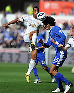 Swansea city's Jonathan De Guzman (l) battles for the ball with Everton's Marouane Fellaini (25).  Barclays Premier league, Swansea city v Everton at the Liberty stadium in Swansea, South Wales on Sat 22nd Sept 2012.   pic by  Andrew Orchard, Andrew Orchard sports photography,