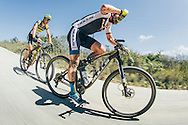 The leader on the road for much of the 2017 Fairview Attakwas Extreme MTB Challenge, Karl Platt of Team Bulls, refuels for the climbs ahead while Kristian Hynek follows close on Platt's wheel. Photo by: Ewald Sadie/Dryland/SPORTZPICS