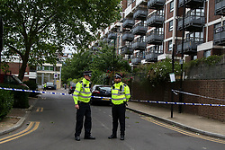 © Licensed to London News Pictures. 06/06/2020. London, UK. Police officers guard a crime scene on Brackenfield Close, Hackney in East London as police launch an investigation following a fatal shooting. Police were called at 11.30 pm on Friday 5 June, to reports of shots fired in Brackenfield Close and found a man in his twenties suffering gunshot injuries. Despite the efforts of medics and officers, the man was pronounced dead at the scene. Photo credit: Dinendra Haria/LNP