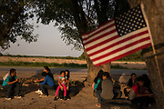 Central American migrants seeking asylum who illegally crossed the Rio Grande nearby wait to be transported to a processing facility after turning themselves in to U.S. Border Patrol in Los Ebanos, Texas, U.S., June 28, 2019.