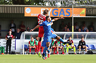 AFC Wimbledon striker Kweshi Appiah (9) battles for possession with Scunthorpe United defender Charlie Goode (20) during the EFL Sky Bet League 1 match between AFC Wimbledon and Scunthorpe United at the Cherry Red Records Stadium, Kingston, England on 15 September 2018.