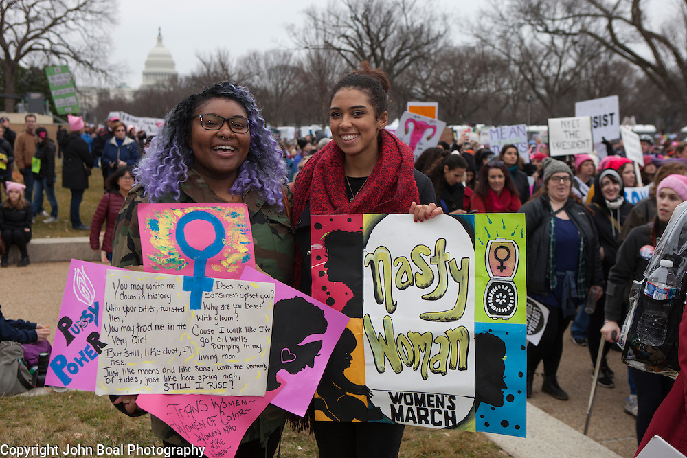 """Aleshia Faust, left, and Michelle Coleman attended the Women's March on Washington where an anticipated 200,000 people turned into an estimated 500,000 to 1 million people, on Saturday, January 21, 2017.  When asked about their hopes for the next 4 years, Faust said, """"...I hope I'm wrong about Donald Trump...I hope he'll unite us and not divide us...""""  Coleman added, """"...I hope he'll hear our voices and how many of us exist...and I hope we'll survive...""""  John Boal Photography"""