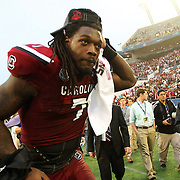 South Carolina Gamecocks defensive end Jadeveon Clowney (7) celebrates on the field after the NCAA Capital One Bowl football game between the South Carolina Gamecocks who represent the SEC and the Wisconsin Badgers who represent the Big 10 Conference, at the Florida Citrus Bowl on Wednesday, January 1, 2014 in Orlando, Florida.   South Carolina won the game 34-24. (AP Photo/Alex Menendez)