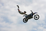 A Moto X rider completes a Superman seat grab at the 2008 Yankee Lake Extreme Sports and Music Festival in Brookfield, Ohio.