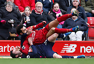 Mohamed Salah of Liverpool gets tackled by Lewis Cook of Bournemouth during the Premier League match at Anfield, Liverpool. Picture date: 7th March 2020. Picture credit should read: Darren Staples/Sportimage