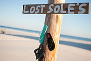 A sign for lost soles, shoes, on the beach in Florida.